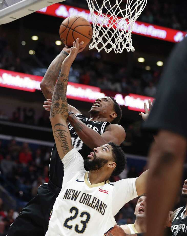 DeMar DeRozan, top, scored 19 points, but Anthony Davis (29 points) was one of four to surpass 20 points against the Spurs. Photo: Gerald Herbert / Associated Press / Copyright 2018 The Associated Press. All rights reserved.