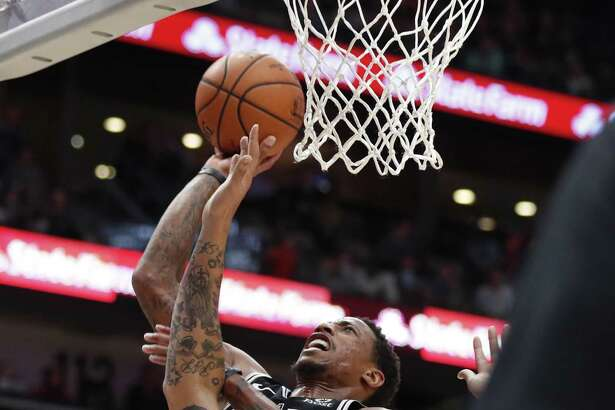 DeMar DeRozan, top, scored 19 points, but Anthony Davis (29 points) was one of four to surpass 20 points against the Spurs.