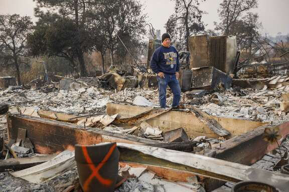 John Wiggins stands on his destroyed property after the Camp Fire raged through in Paradise.