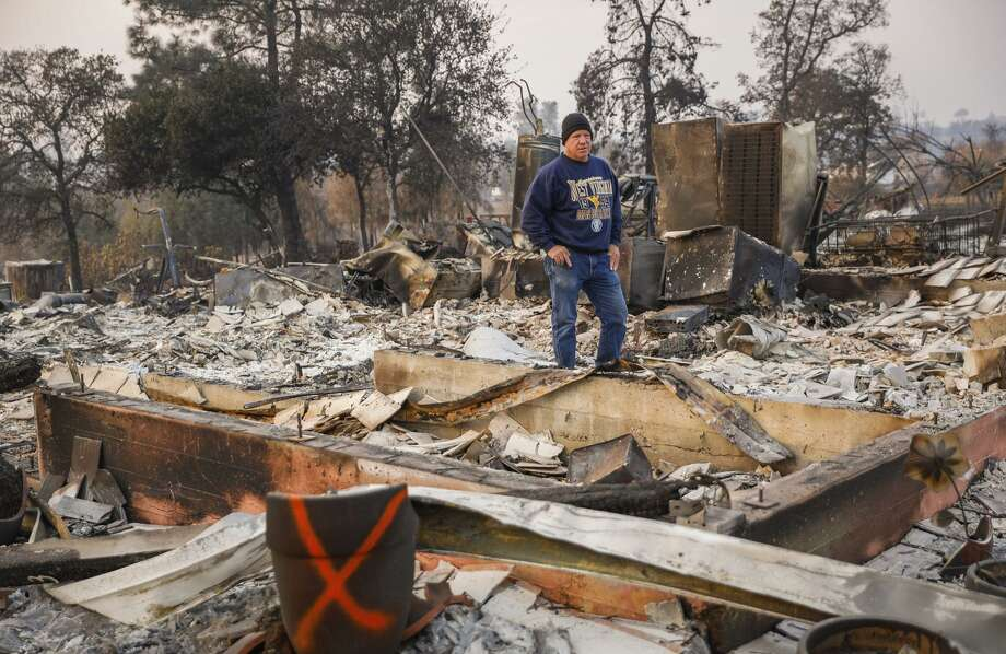 John Wiggins stands on his destroyed property after the Camp Fire raged through in Paradise. Photo: Gabrielle Lurie / The Chronicle / ONLINE_YES