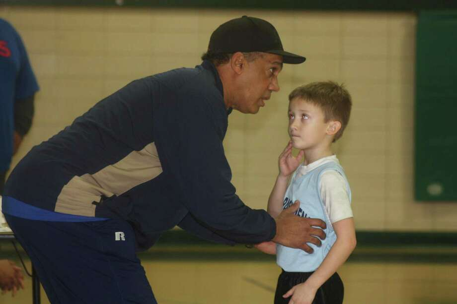 A youngster receives instruction from his coach during a big moment in a youth game at Park View Intermediate. In the 7 and 8s division, the league uses 8-foot goals. Photo: Robert Avery