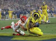Los Angeles Rams tight end Gerald Everett (81) scores a touchdown after catching a pass ahead of Kansas City Chiefs defensive back Daniel Sorensen, left, during the second half of an NFL football game, Monday, Nov. 19, 2018, in Los Angeles. (AP Photo/Marcio Jose Sanchez)