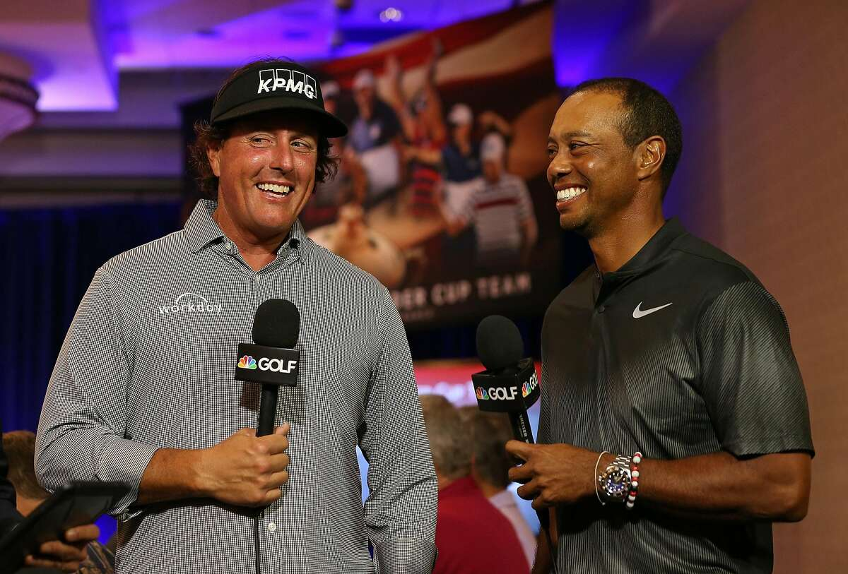 WEST CONSHOHOCKEN, PA - SEPTEMBER 04: Phil Mickelson and Tiger Woods are interviewed by the Golf Channel after being named as Captain's Picks along with Bryson DeChambeau by U.S. Ryder Cup Captain for the 2018 U.S. team during a press conference at the Philadelphia Marriott West on September 4, 2018 in West Conshohocken, Pennsylvania. (Photo by Rich Schultz/Getty Images)