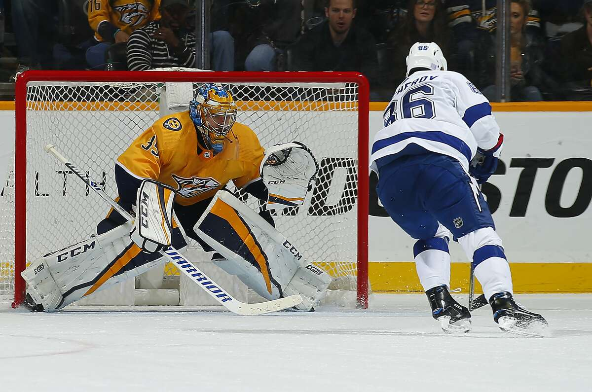 NASHVILLE, TENNESSEE - NOVEMBER 19: Goalie Pekka Rinne #35 makes a save on a shot by Nikita Kucherov #86 of the Tampa Bay Lightning during the third period at Bridgestone Arena on November 19, 2018 in Nashville, Tennessee. (Photo by Frederick Breedon/Getty Images)