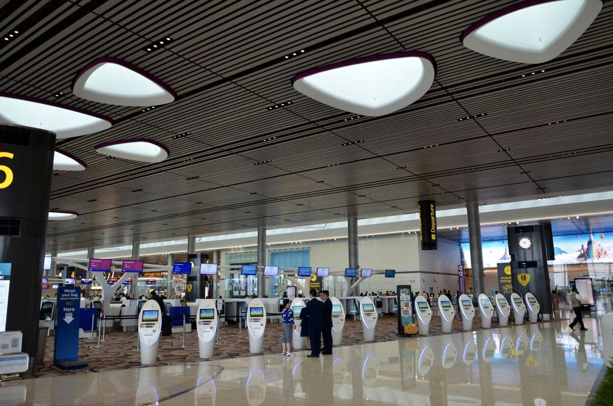Spacious, airy and modern, Terminal 4 at Singapore's Changi Airport is a glimpse of the future of air travel. These check-in kiosks are dotted throughout the grand hall, providing ample places for passengers to get boarding passes printed out.