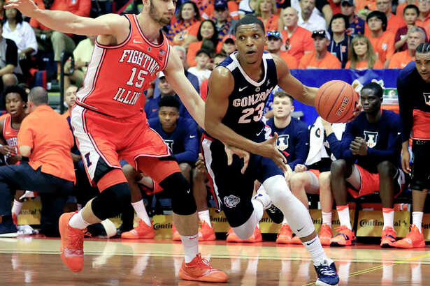 Gonzaga guard Zach Norvell Jr. (23) dribbles past Illinois forward Giorgi Bezhanishvili (15) Monday night at the Maui Invitational in Lahaina, Hawaii.
