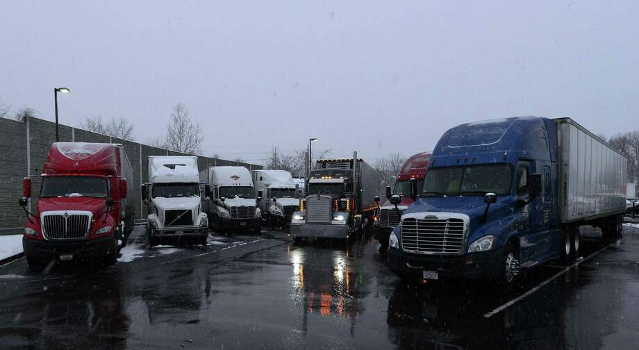 A nationwide shortage in truck drivers has driven up shipping costs for consumers. Photo: Matthew Brown / Hearst Connecticut Media / Stamford Advocate