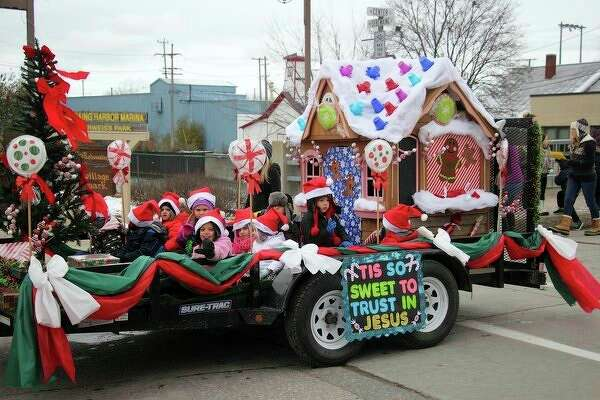 A group of cute young Santas helped spread holiday cheer whileriding in this float at theSebewaing Spirit of Christmas Festival Parade on Saturday morning. (Seth Stapleton/Huron Daily Tribune)