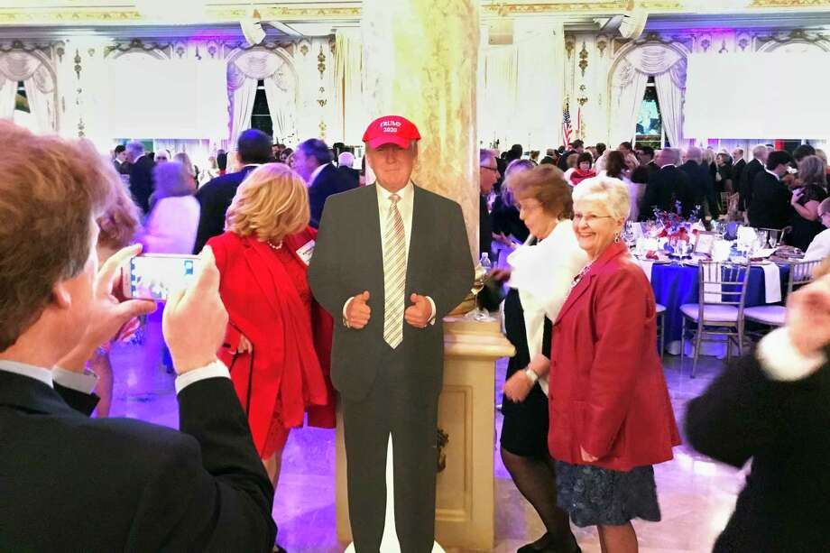"Supporters of President Donald Trump pose with a cardboard cutout at the entrance to the Donald J. Trump Grand Ballroom at Trump's Mar-a-Lago Club in Palm Beach, Florida, on Jan. 18, 2018. The event was put on by the ""Trumpettes USA."" Photo: Washington Post Photo By David A. Fahrenthold / The Washington Post"