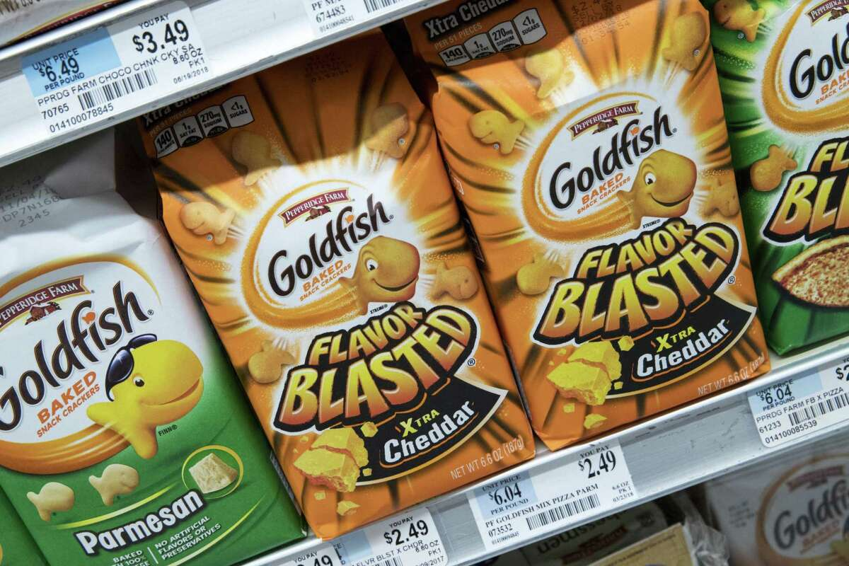 Pepperidge Farm Goldfish Flavor Blasted Xtra Cheddar crackers on display in July 2018 in New York City, with the flavor one of four varieties of Goldfish recalled by Pepperidge Farm on the possibility of contaminated whey powder that may have been used as an ingredient. (AP Photo/Mary Altaffer)