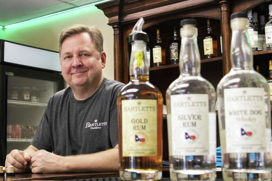 Bartletts Distillery president Van Brackin stands behind the bar at Bartletts Distillery on Friday in Conroe. Bracking opened his business to the public July, 2018 and has since made a variety of rums and whiskey. Photo: Cody Bahn, Houston Chronicle / Staff Photographer / © 2018 Houston Chronicle