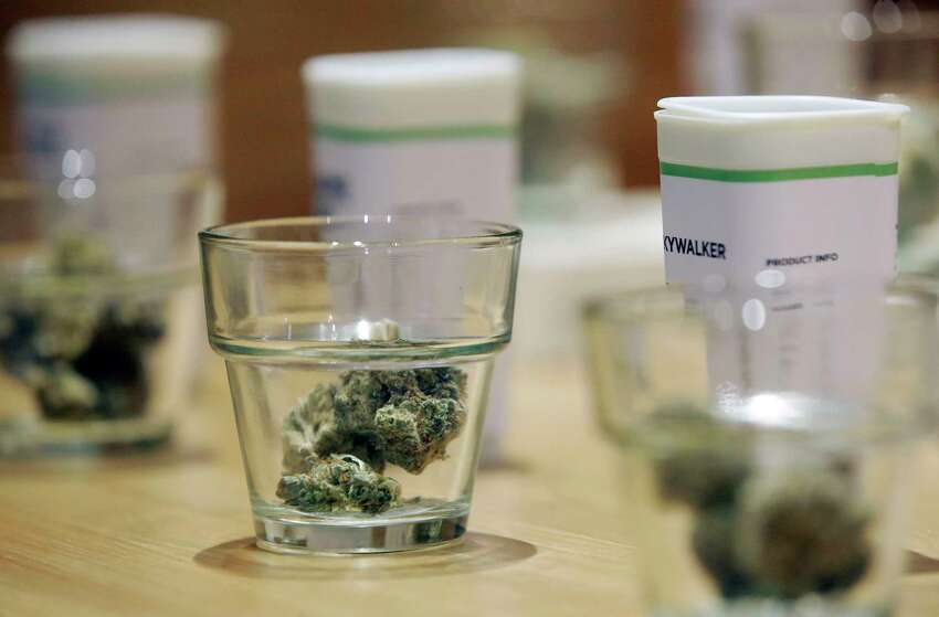 Cannabis products are displayed at the Cultivate dispensary on the first day of legal recreational marijuana sales, Tuesday, Nov. 20, 2018, in Leicester, Mass. Cultivate is one of the first two shops permitted to sell recreational marijuana in the eastern United States, more than two years after Massachusetts voters approved it in 2016.