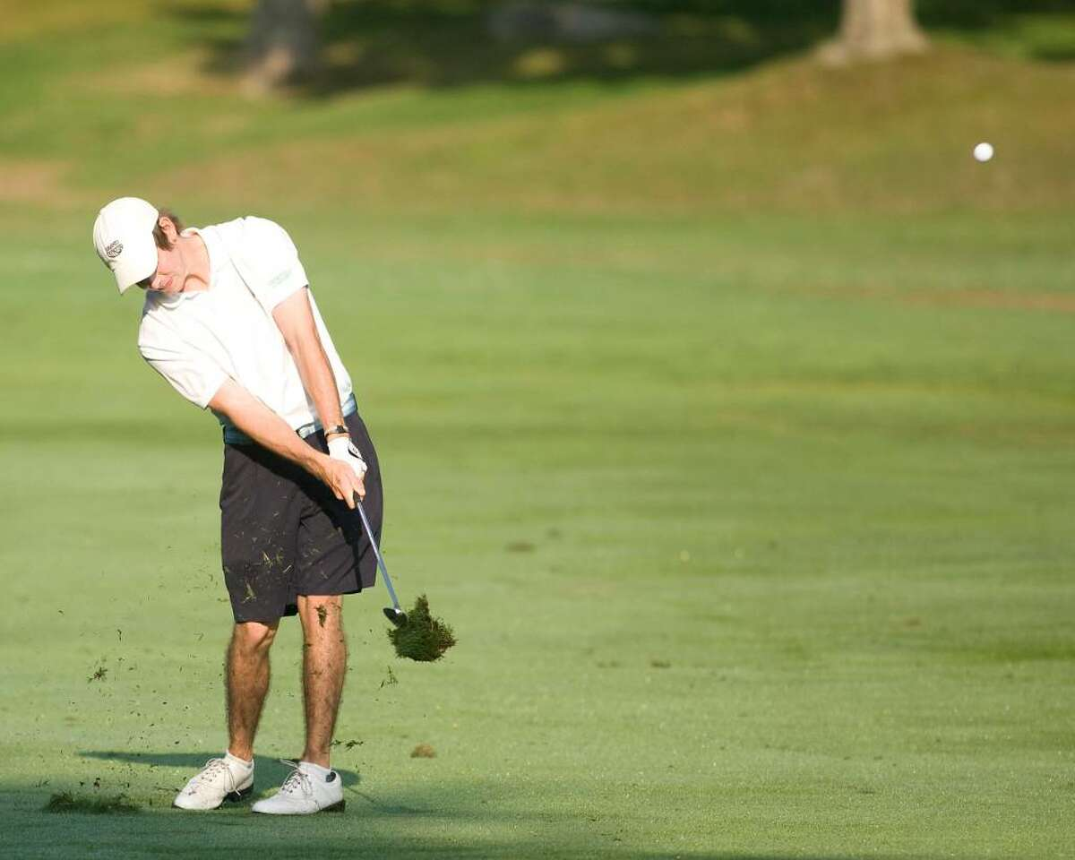 Defending champion James Smith takes a divot but gets his ball on the green during first round play in the 20th annual Danbury Amateur Tournament Saturday at Richter Park Golf Course.