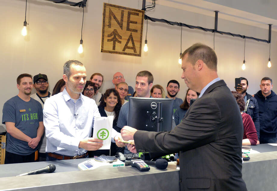 "NETA co-founder Arnon Vered sells Northampton Mayor David Narkewicz the first legal recruitment sale of marijuana at the NETA plant on Tuesday, November 20, 201<div class=""e3lan e3lan-in-post1""><script async src=""//pagead2.googlesyndication.com/pagead/js/adsbygoogle.js""></script>