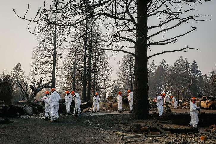 Search and Recovery crew members from Oregon looks for remains off of Edgewood Lane after the Camp Fire destroyed the town of Paradise, California, on Monday, Nov. 19, 2018.