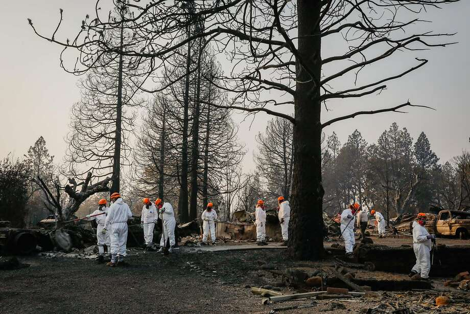 Search and Recovery crew members work after the Camp Fire destroyed the town of Paradise, California. Photo: Gabrielle Lurie / The Chronicle