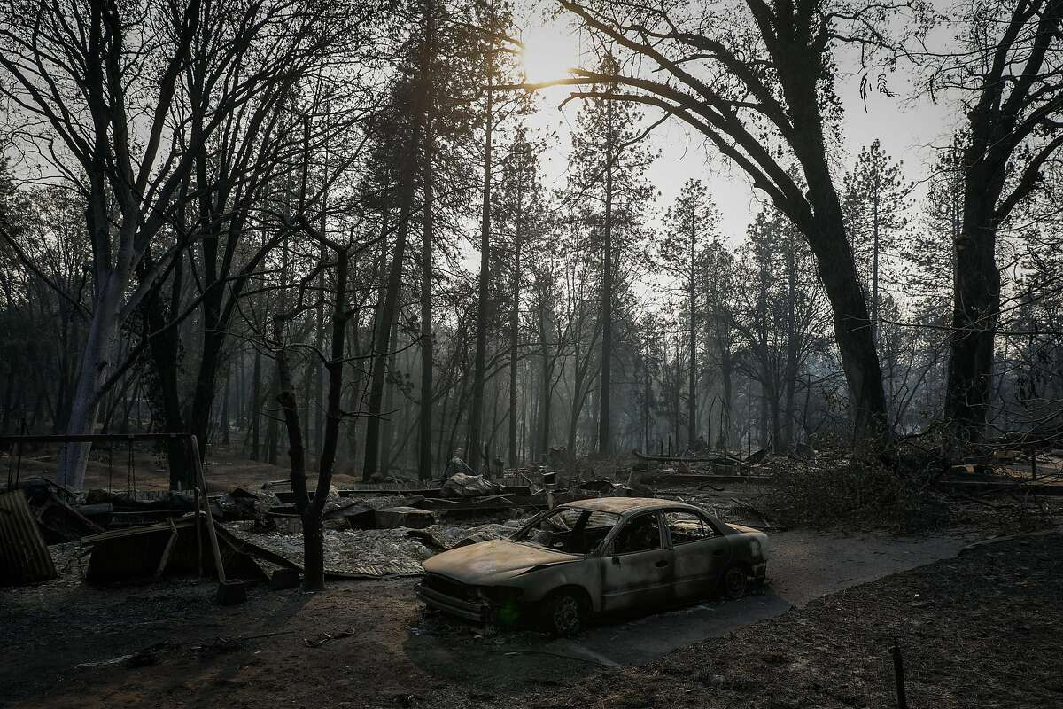 A burned out car on Pearson Road after the Camp Fire destroyed the town of Paradise, California, on Monday, Nov. 19, 2018.