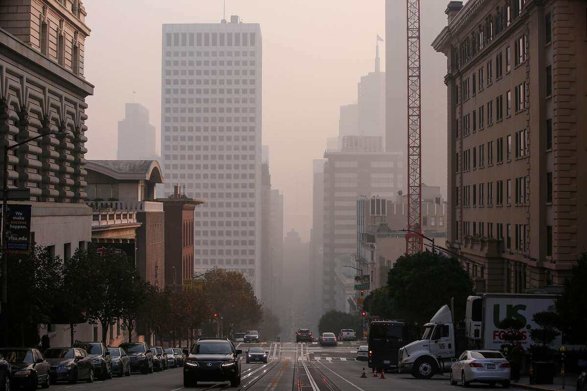 The air quality in San Francisco has reached the purple on the Air Quality Index (AQI) as the skyline is shrouded in smoke from the Camp Fire on Friday, Nov. 16, 2018 in San Francisco, Calif.