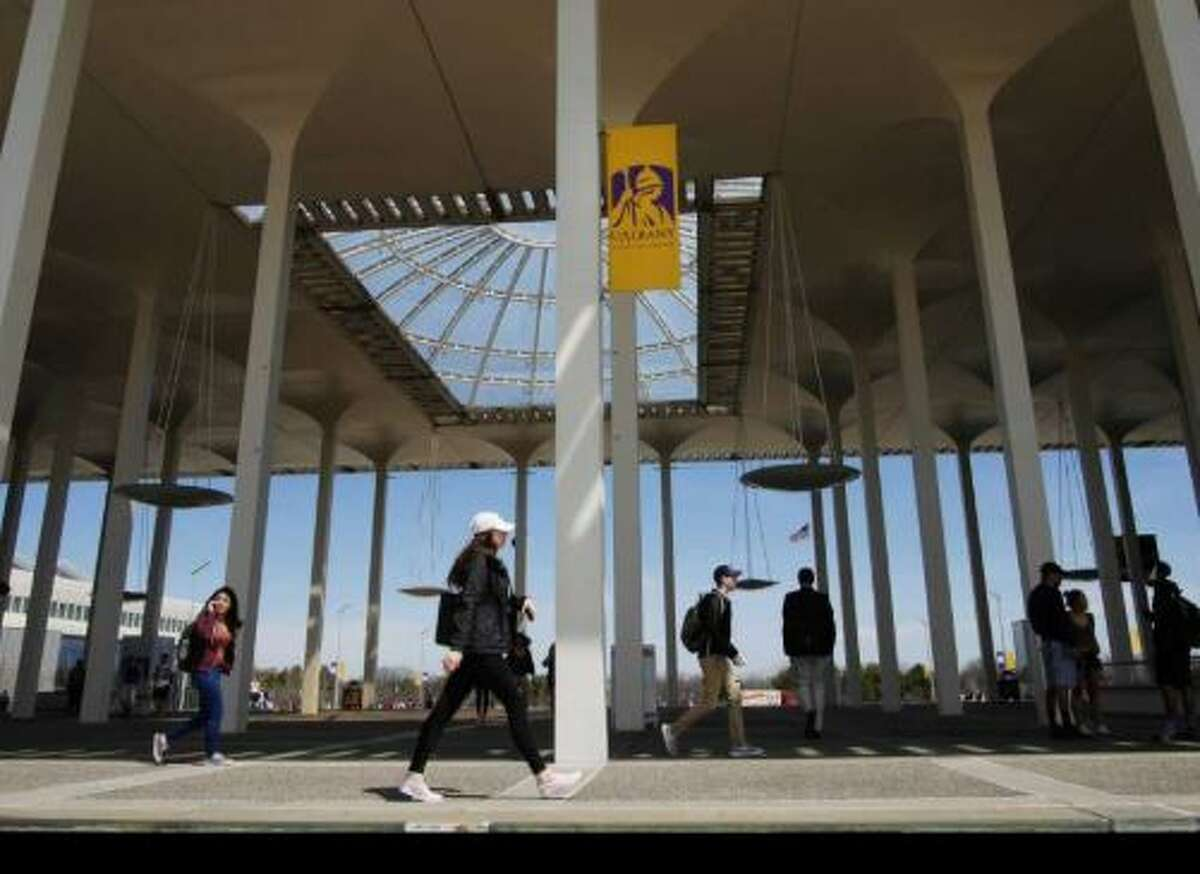 University at Albany students make their way between classes on Monday, April 10, 2017, in Albany, N.Y.