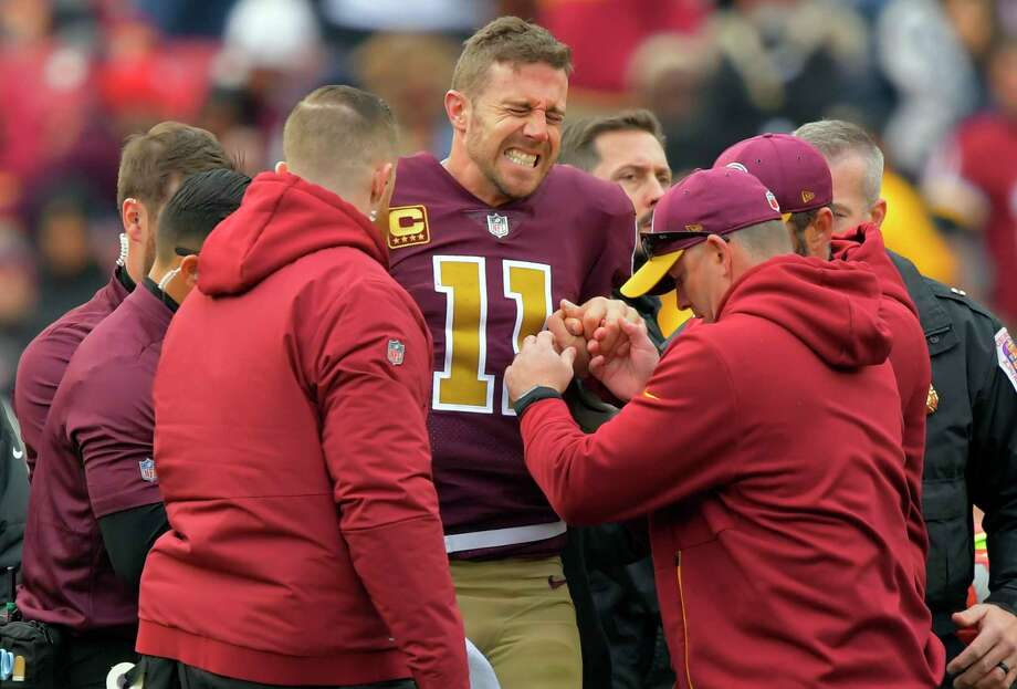 Washington quarterback Alex Smith broke two bones in his leg on Sunday. Photo: Washington Post Photo By John McDonnell / The Washington Post