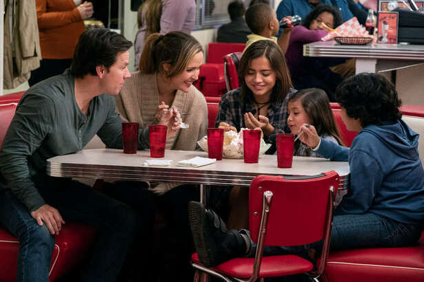 """This image released by Paramount Pictures shows Mark Wahlberg, from left, Rose Byrne, Isabela Moner, Julianna Gamiz and Gustavo Quiroz in a scene from """"Instant Family."""""""