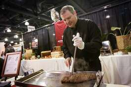 In this file photo, Vanderlei Bernardi, Executive Chef of Avenida Brazil Churrascaria Steakhouse, preps beef sirloin with au gratin potatoes during Taste of the Town on Thursday, Jan. 18, 2018, at The Woodlands Waterway Marriott Hotel & Convention Center. This year's event is set for Jan. 17 from 4 to 9 p.m. at The Woodlands Waterway Marriott.