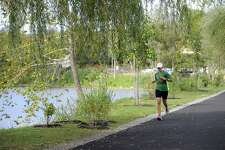 A runner uses the Young's Field Riverwalk in New Milford on in October 2017.