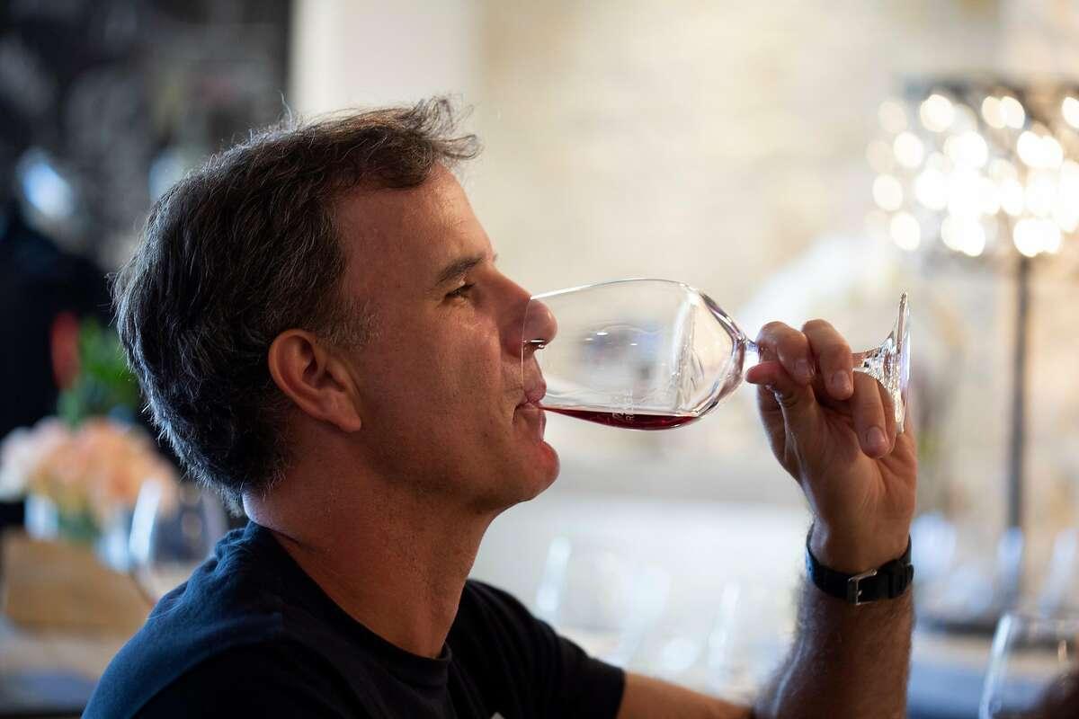 Jeremy Lampel, of Santa Cruz, tries the wines at the Albatross Ridge wine tasting room in Carmel, Calif. on Sunday, June 24, 2018.