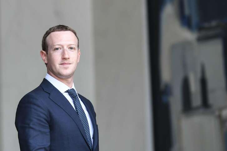 "(FILES) In this file photo taken on May 23, 2018 Facebook's CEO Mark Zuckerberg leaves the Elysee presidential palace, in Paris,  following a meeting with French President on the day of the ""Tech for Good"" summit. - Facebook chief Mark Zuckerberg on November 15, 2018 sought to quell a new firestorm over the social network's handling of Russian misinformation efforts in 2016 and its hiring of a consulting firm that used questionable tactics to target the company's critics.Speaking on a conference call on content moderation efforts, Zuckerberg repeated his comments that Facebook was slow to spot Russian interference in the 2016 election but argued that ""to suggest we weren't interested in knowing the truth or that we wanted to hide what we knew or stop investigations is simply untrue."" (Photo by Alain JOCARD / AFP)ALAIN JOCARD/AFP/Getty Images"