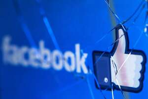 """(FILES) In this file photo taken on May 16, 2018 shows the logo of the social network Facebook on a broken screen of a mobile phone. - Facebook said Thursday, November 15, 2018 it was severing ties with a political consultancy that sought to discredit critics of the social networking giant using questionable campaign-style tactics. The California-based company's announcement followed a lengthy New York Times investigation detailing Facebook's struggles with its image as it came under scrutiny for its handling of Russian-led misinformation efforts. Facebook said in a statement that """"we ended our contract"""" with Definers Public Affairs, which specializes in opposition research and, according to the Times, sought to link anti-Facebook efforts to financier George Soros. But Facebook disputed claims that it used the firm in a nefarious way. (Photo by JOEL SAGET / AFP)JOEL SAGET/AFP/Getty Images"""