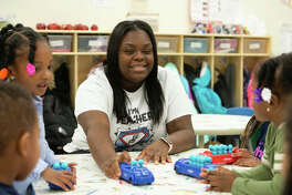 Working in a job she loves, Kei'lah Brown-McGee helps students as a teacher's assistant at the SIUE Head Start/Early Head Start's Discover Center for Little Scholars.