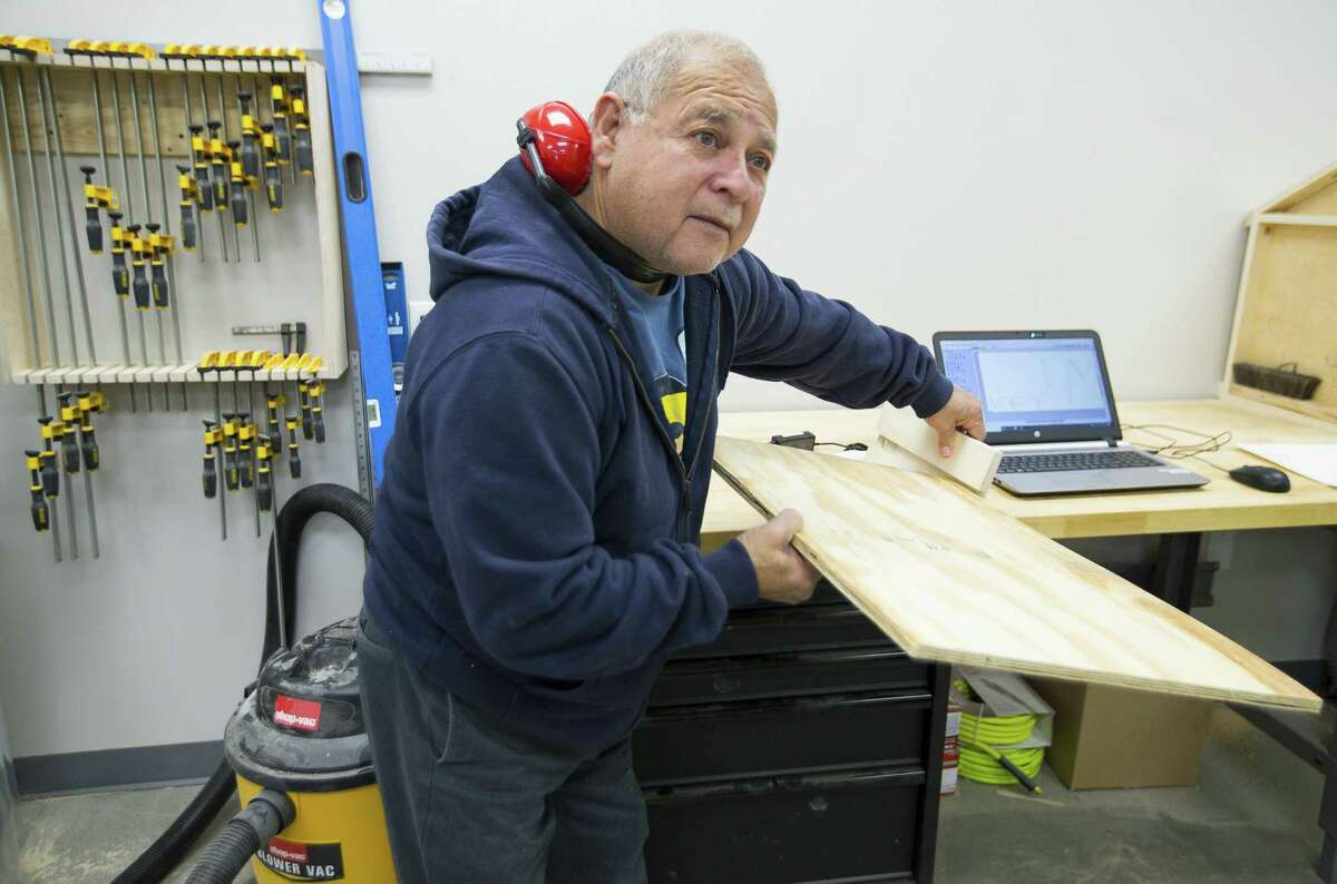 Johnny Ramirez works on a woodworking project inside the FabLab, a maker spacer, that is part of the new Baker Ripley East Aldine community center, Thursday, Nov. 15, 2018 in Houston.