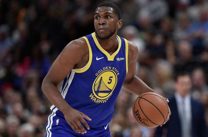 Kevon Looney of the Golden State Warriors controls the ball in a NBA game against the Utah Jazz at Vivint Smart Home Arena on October 19, 2018 in Salt Lake City, Utah.