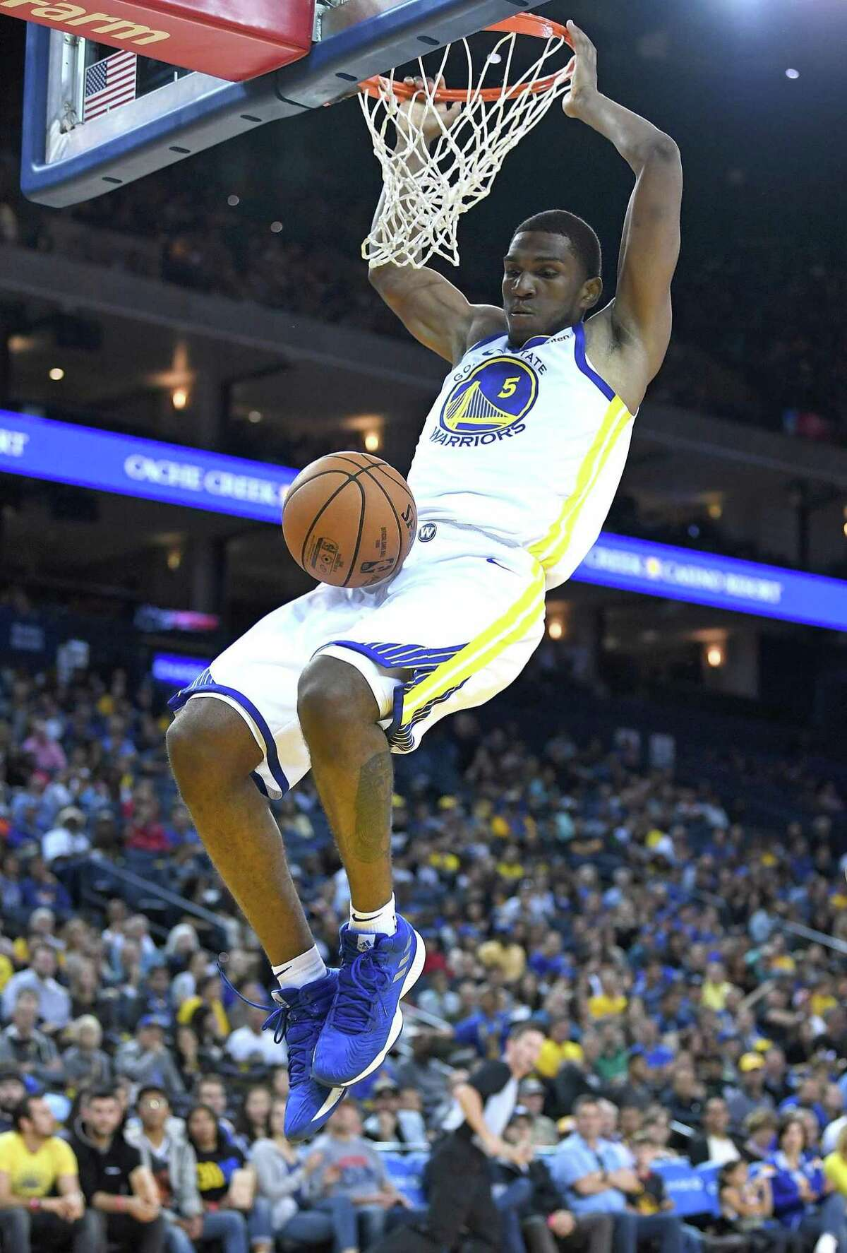 Kevon Looney, shown dunking in an exhibition game, has started the past two games.