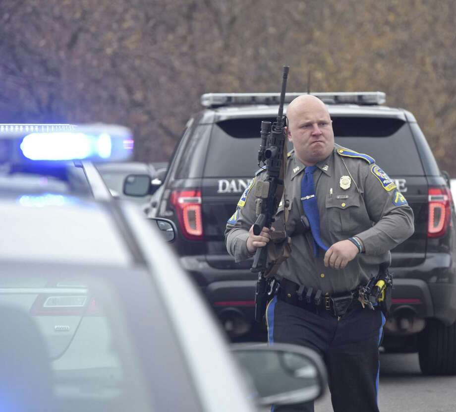 Connecticut State Trooper 1st class Benjamin Pagoni, from Troop A, responds to the Visual & Performing Arts Center on the Western Connecticut State University Westside campus after an active shooter was reported on the campus Tuesday afternoon. November 20, 2018, in Danbury, Conn. It was a false alarm. Photo: H John Voorhees III / Hearst Connecticut Media / The News-Times
