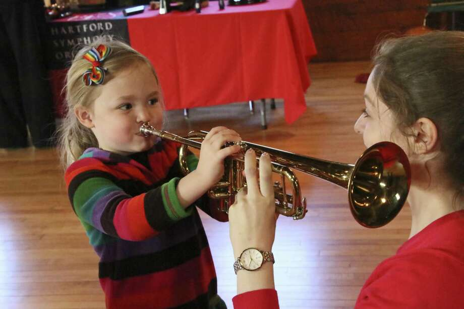 Hartford Symphony Orchestra will present its Family Series at Connecticut Science Center, offering children the opportunity to try out an instrument. Photo: Hartford Symphony Orchestra / Contributed Photo