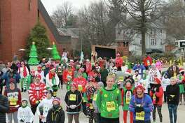 Runners festively participate in a previous CHRISTmas Ugly Sweater 5K hosted by Trinity Lutheran Ministries. The third annual event is set this year on Saturday, Dec. 8.