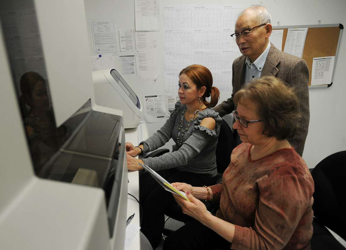 Pathologist Sin Hang Lee, MD, and technicians Wilda Garayua, left, and Gloria Jerolman use DNA sequencing for early diagnosis of Lyme Disease at Milford Molecular Diagnostics, LLC at 2044 Bridgeport Avenue in Milford, Conn. on Tuesday, November 13, 2018. Lee is suing the CDC over their current method of testing for the disease.