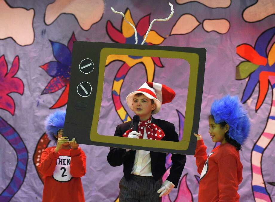 "Sean Bocchino, playing Cat in the Hat, acts out a scene with Alejandra Martinez, Thing 2, and Mia Melgar, Thing 1, during the dress rehearsal of ""Seussical Kids!"" at New Lebanon School in the Byram section of Greenwich, Conn. Monday, Nov. 19, 2018. Two performances of the Dr. Seuss-themed musical will take place Turesday, Nov. 20 at 1:30 p.m. and 7 p.m. Photo: Tyler Sizemore / Hearst Connecticut Media / Greenwich Time"