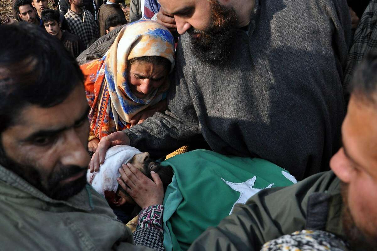 EDITORS NOTE: Graphic content / Relatives mourn over the body of Tehreek-e-Hurriyat separatist leader Hafizullah Mir in southern Kashmirs Anantnag district on November 20, 2018. - Mir, who was district president of the Tehreek-e-Hurriyat separatist group, was gunned down at his residence by unidentified gunmen on November 20. (Photo by HABIB NAQASH / AFP)HABIB NAQASH/AFP/Getty Images