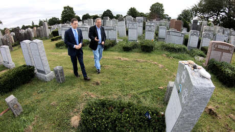 Mark Albert and Rich Zemser visit the grave site of Zemser's nephew, Justin, who died in the crash of Amtrak 188 in Philadelphia on May 12, 2015 Photo: HTV