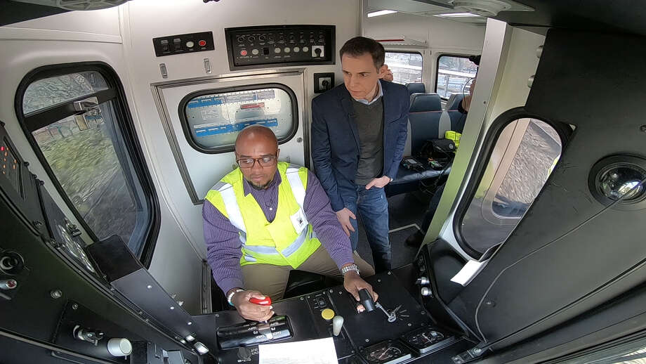 SEPTA Director of Operations Pat Desir and Mark Albert inside the cab of a train equipped with PTC; courtesy: Hearst Television Photo: HTV