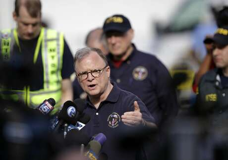 National Transportation Safety Board member Robert Sumwalt answers a question during a news conference near the scene of a deadly train derailment, Wednesday, May 13, 2015, in Philadelphia. An Amtrak train headed to New York City derailed and crashed in Philadelphia on Tuesday night killing eight people and and sending more than 200 passengers and crew to area hospitals. (AP Photo/Mel Evans) Photo: HTV