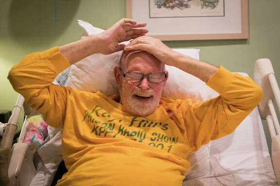 Ray Hill bursts out in laughter while telling stories about his life from a hospice bed in the Omega House, Saturday, Nov. 3, 2018, in Houston. Hill is a renowned gay activist and prison radio host.