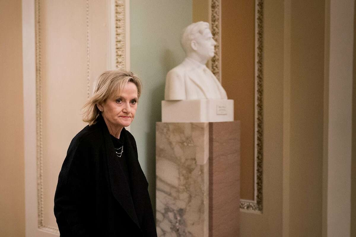 Sen. Cindy Hyde-Smith (R-Miss.) walks to a vote on Capitol Hill in Washington, Nov. 13, 2018. With polls showing Hyde-Smith's advantage dwindling, Republicans have scrambled to find new lines of attack against Mike Espy, a former member of Congress and agriculture secretary under President Bill Clinton. (Erin Schaff/The New York Times)