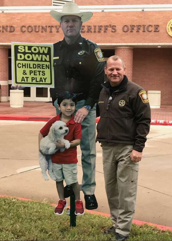 Fort Bend County Sheriff Troy Nehls' custom-made traffic signs have caught the attention of residents that say they are tired of reckless drivers speeding through their neighborhoods. Photo: Courtesy Fort Bend County Sheriff Troy Nehls