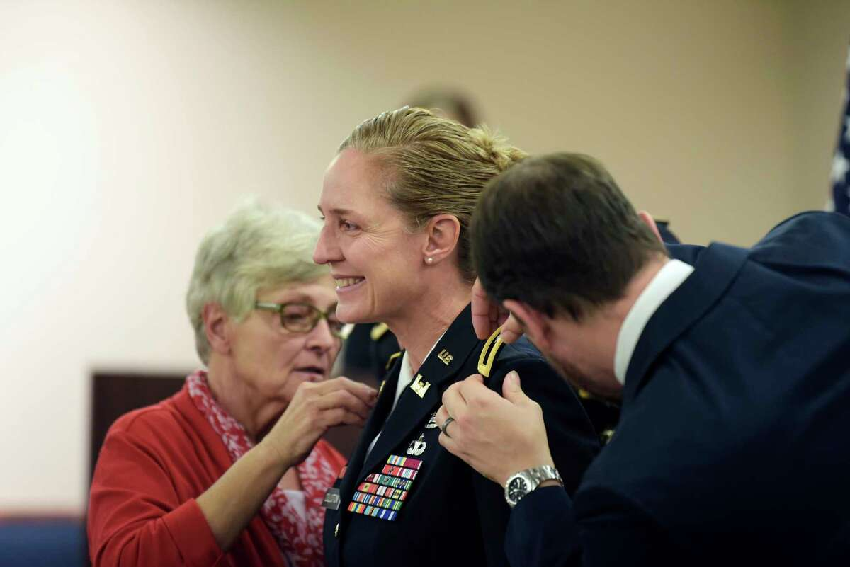 Rensselaer Polytechnic Institute alumna Brigadier General Kim Colloton, Commander South Pacific Division U.S. Army Corps of Engineers, has her mother, Bernadine Colloton, and her husband, Mike Krulc, place the one star on each of her shoulders during her promotion ceremony at RPI on Tuesday, Nov. 20, 2018, in Troy, N.Y. (Paul Buckowski/Times Union)