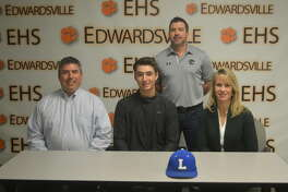 Edwardsville senior Dawson Taylor signed to play baseball at John A. Logan College in Carterville. In the front row, from left to right, are father Shane Taylor, Dawson Taylor and mother Cathy Taylor. EHS coach Tim Funkhouser is in the back.