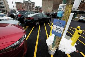 A sign in the parking lot at 208 Washington Avenue denotes the location of the parking spot for the Capital CarShare vehicle Monday Nov. 19,  Nov. 16, 2018 in Albany N.Y., N.Y.  (Skip Dickstein/Times Union)