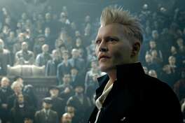 """This image released by Warner Bros. Pictures shows Johnny Depp in a scene from """"Fantastic Beasts: The Crimes of Grindelwald."""" (Warner Bros. Pictures via AP)"""